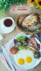 Asanoya Mega Breakfast   - Salad, sauteed mushrooms, baked tomato, chicken chipolata, streaky bacon, bread basketServed with salad and drinks. (Hot Coffee / Iced/ Hot Tea )